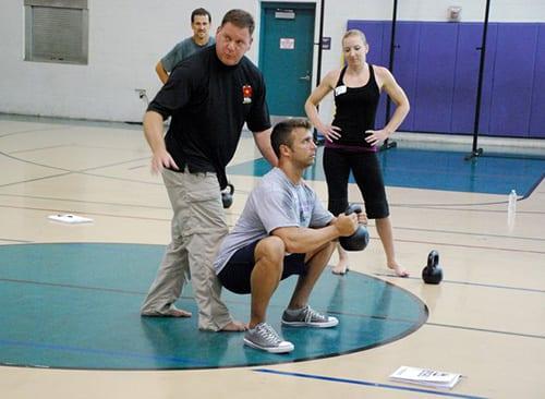 Dan John coaches a goblet squat